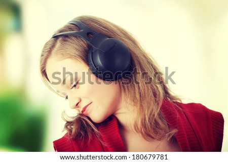 Listening to the Music, young caucasian beautiful blond woman with headphones - stock photo