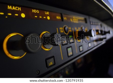 lit aircraft instrument control panel - stock photo