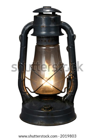Lit Antique oil lamp with clipping path - stock photo