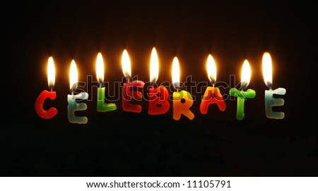 "lit candles spelling word ""celebrate"""