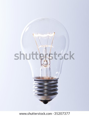 Lit light bulb, isolated - stock photo
