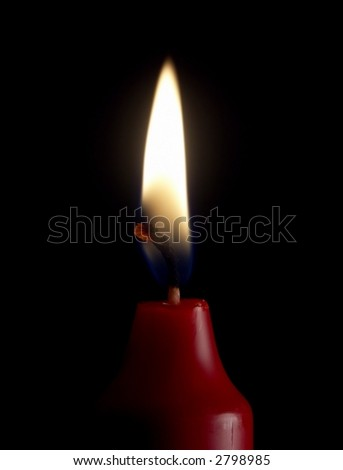 Lit red candle isolated on black. - stock photo