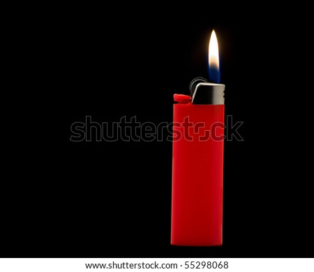 Lit red lighter isolated on black background - stock photo