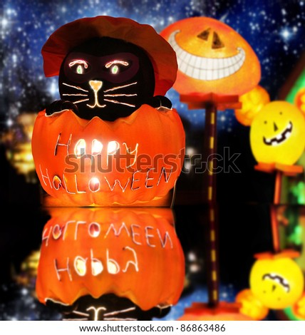 Lit up stylized Halloween composition of warm glowing spooky fun figures against fantastical night background - stock photo