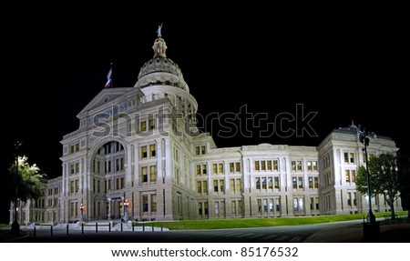 Lit up Texas Capitol at night shot with a wide angle lens.