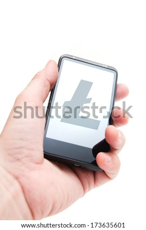 Litecoin currency symbol. Hand holding smart phone mobile with litecoin currency symbol. - stock photo