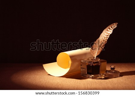 literature symbol old inkstand near scroll stock photo  literature symbol old inkstand near scroll on canvas background