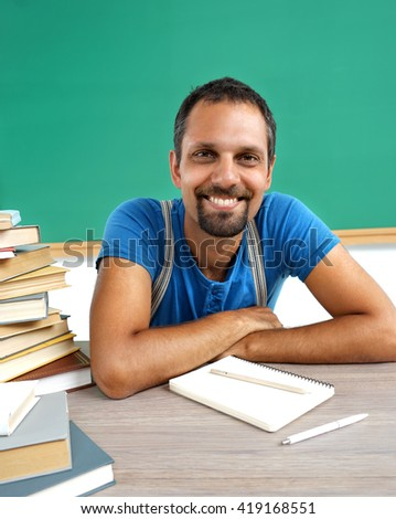 Literature teacher. Photo adult man with books in classroom, creative concept with Back to school theme
