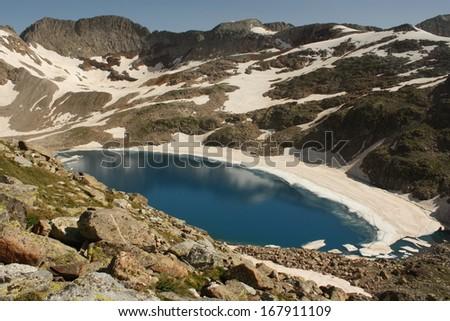 Literola lake in Aragon Pyrenees - stock photo