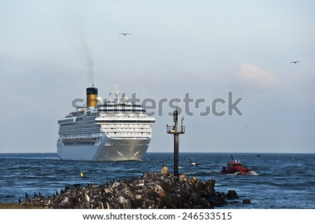 LITHUANIA- AUG 17: cruise liner and tug by pier on August,2012 in Lithuania. - stock photo