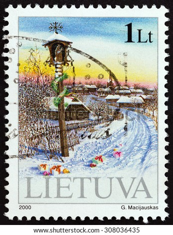"""LITHUANIA - CIRCA 2000: A stamp printed in Lithuania from the """"Christmas and New Year """" issue shows winter landscape, circa 2000.  - stock photo"""