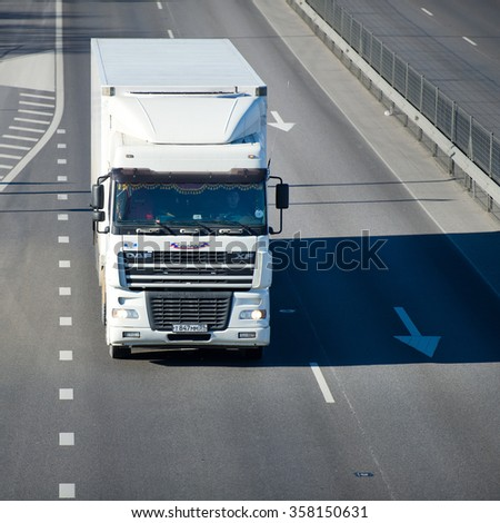 LITHUANIA - FEB 16: DAF XF truck on motorway on Feb 16, 2015 in Lithuania. The DAF XF is a range of trucks produced by the Dutch manufacturer DAF since 1997. - stock photo
