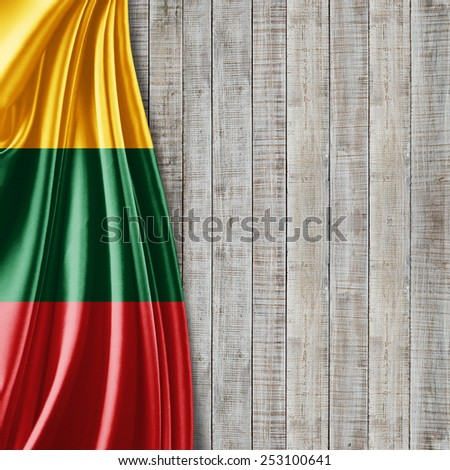 Lithuania flag and wood background - stock photo