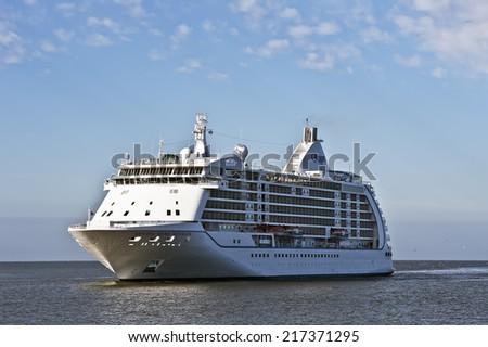 LITHUANIA- SEPTEMBER 14:Cruise liner Seven Seas Voyager in Baltic Sea on September 14,2014 in Lithuania. Seven Seas Voyager is a cruise ship for Regent Seven Seas Cruises.  - stock photo