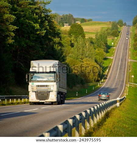 LITHUANIA - SEPTEMBER 3: DAF XF truck on motorway on September 3, 2014 in Lithuania. The DAF XF is a range of trucks produced by the Dutch manufacturer DAF since 1997. - stock photo