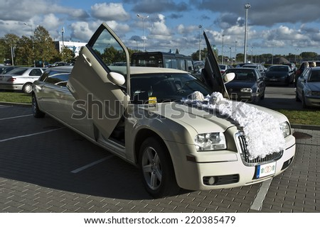 LITHUANIA-SEPTEMBER 25:Wedding limo rent on September 25,2014 in Lithuania.A limousine (or limo) is a luxury sedan or saloon car.  - stock photo