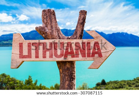 Lithuania wooden sign with lake background - stock photo