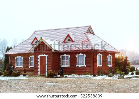 Lithuanian countryside, snowy winter. Baltic rustic architecture with wooden houses, landscaped Park and restaurant of traditional cuisine Griezpelkiai. Republic of Lithuania, European Union