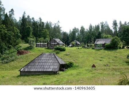 Lithuanian landscape, village view with old houses between forest, typical lithuanian village view in summer, Lithuania, village view, old traditional houses, Ignalina, village in the middle of forest - stock photo