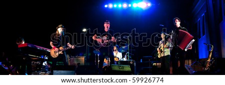 LITIJA, SLOVENIA - AUGUST 27: Slovenian musician and songwriter Vlado Kreslin and his group Mali bogovi perform at the concert with St. Nicholas Choir on August 27, 2010 in Litija, Slovenia, EU.