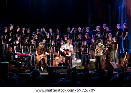 LITIJA, SLOVENIA - AUGUST 27: Slovenian musician Vlado Kreslin and his group Mali bogovi perform at the concert with St. Nicholas Choir on August 27, 2010 in Litija, Slovenia, EU.