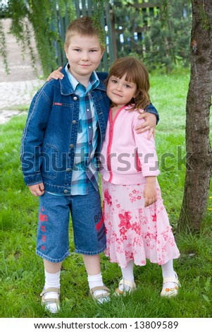 litle boy and pretty girl, portrait outdoors