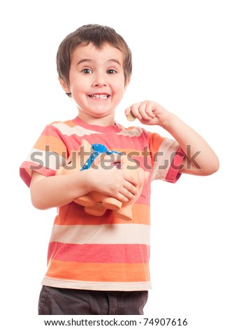 Litle boy puts the coin into the piggy bank isolated on white - stock photo