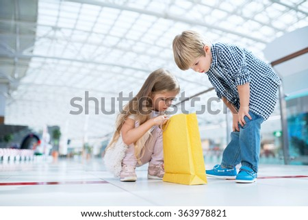 Litle children with bag in a store - stock photo