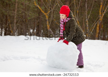 Litle girl making snowballs, happy little girl portrait - stock photo