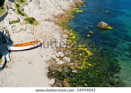 Litlle boat on the beach in Sozopol,Bulgaria - stock photo