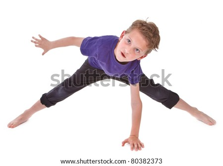 litte boy is trying to make twine on white background - stock photo