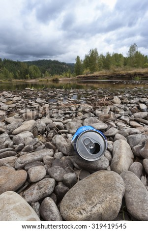 Litter on the river bed in north Idaho. - stock photo