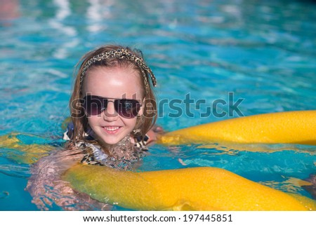 Little adorable girl have fun in the swimming pool