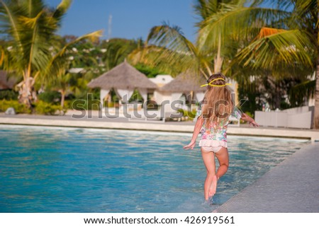 Little adorable girl in outdoor swimming pool - stock photo