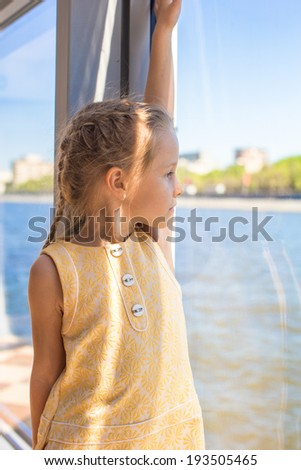 Little adorable girl relaxing on a luxury ship
