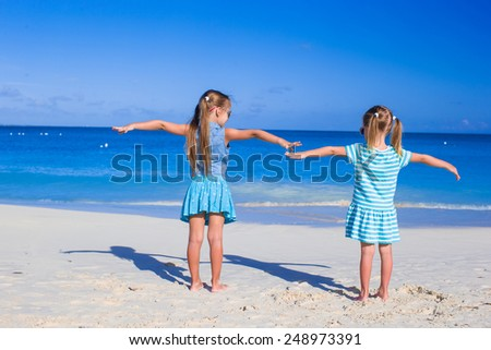 Little adorable girls on summer vacation at tropical beach