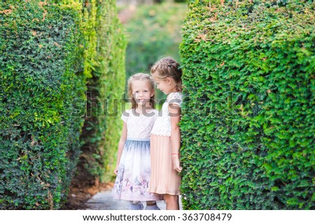 Little adorable girls outdoors at summer time on european vacation - stock photo