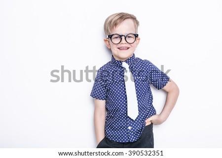 Little adorable kid in tie and glasses. School. Preschool. Fashion. Studio portrait isolated over white background - stock photo