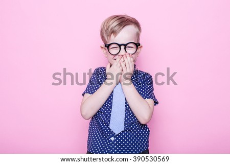 Little adorable kid in tie and glasses. School. Preschool. Fashion. Studio portrait over pink background - stock photo