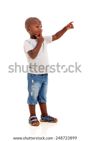 little african boy pointing empty copy space - stock photo