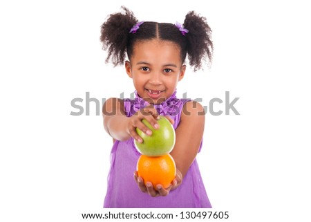 Little African girl with fruit isolated white background - stock photo