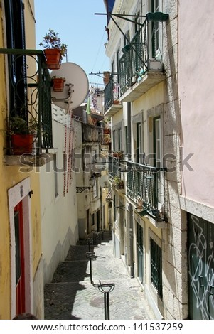 Little alley in Alfama in Lisbon, Portugal - stock photo