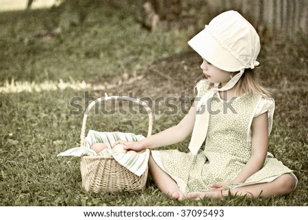 Little Amish girl gathering eggs. Image is a composite of my photos with grain added to increase the vintage effect. - stock photo