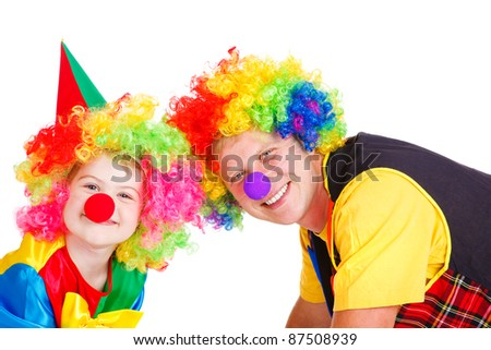 Little and adult clowns in colorful wigs, isolated