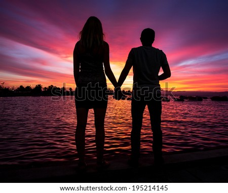 Little and Big couple  and the sunset - stock photo