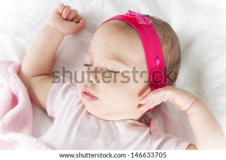 Little and cute baby sleeping on the bed