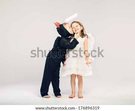 Little angel and devil - stock photo