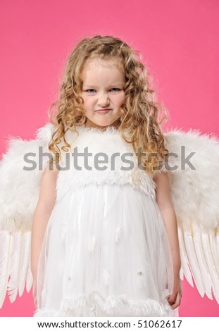 Little angel girl making funny face - stock photo