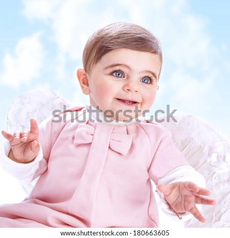 Little angel in heaven, adorable baby girl with white wings on blue cloudy sky background, innocence and purity concept - stock photo