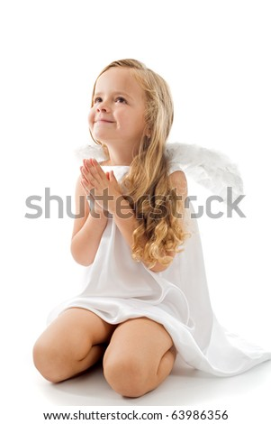 Little angel looking up and praying gratefully - isolated with a bit of shadow - stock photo